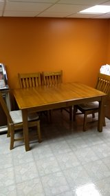 wooden dining room table. with 4 chairs and 18 inch leaf in Plainfield, Illinois