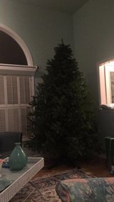 Artificial Christmas tree with 2 sets of string lights included in Elgin, Illinois