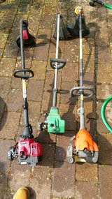 2 gas mowers and 3 gas weedeaters in Ramstein, Germany