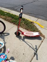 Red electric scooter in Fairfax, Virginia