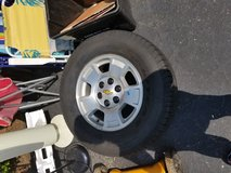 One NEW spare tire with rim in Fairfax, Virginia