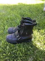 Black Polo leather boots in Fort Leavenworth, Kansas