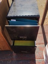 Metal filing cabinet with keys and folders in 29 Palms, California