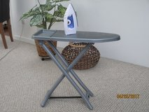 iron and ironing board in Cherry Point, North Carolina