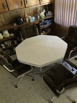 Table and 4 swivel chairs in great condition in Columbia, South Carolina