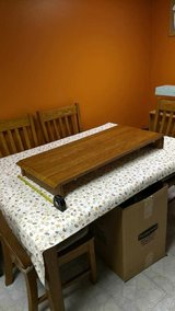 Wooden dining room table with 4 chairs in Orland Park, Illinois