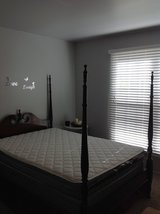 Cherry Four Poster Full size bed with like new mattress in Naperville, Illinois
