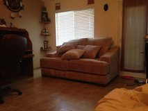 Large loveseat with matching large ottoman. Very good condition. in Hemet, California