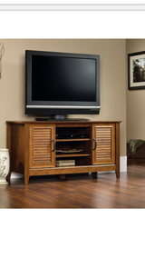 """New Sauder Milled Cherry Panel TV Stand holds up to 47"""" TV in Baytown, Texas"""