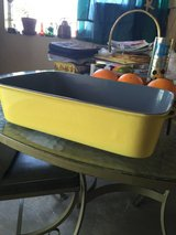 Vintage Sunny yellow cast iron enamel pots in 29 Palms, California
