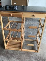 Metal top wine rack utility cabinet in Bartlett, Illinois