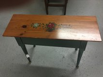 Small table 29 1/2 long 10 in wide has storage in Kingwood, Texas