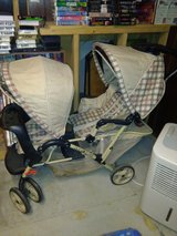 Double beige stroller in Minneapolis, Minnesota