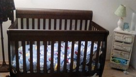Cherry wood 3 in 1 convertible crib/toddler/ reg. bed and drawer/changing set in Ramstein, Germany