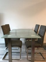 Kitchen Table, Coffee Table, End Table, Futon. All the glass is crackled and in excellent condition in Fort Lewis, Washington
