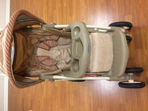 Stroller with matching newborn car seat and base in Bartlett, Illinois