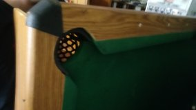 Pool table with cue sticks and balls in Bartlett, Illinois