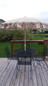 Wrought Iron Table, 4 chairs and umbrella in Morris, Illinois