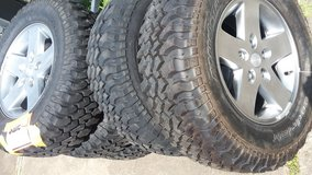 5 tires and rims in Baytown, Texas
