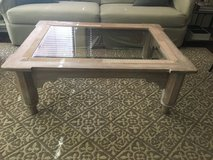Large solid wood and glass coffee table in Travis AFB, California