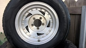 Aluminum wheel with tire in Travis AFB, California
