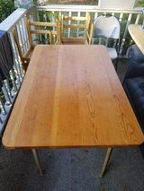 Hardwood table and 4 chairs in Wilmington, North Carolina