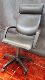 Highback Office Chair with Scuffs on the back in Ramstein, Germany