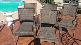 Stacking wicker chairs patio furniture in Lockport, Illinois
