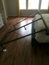 Queen size box spring and metal frame (no mattress) in Kingwood, Texas