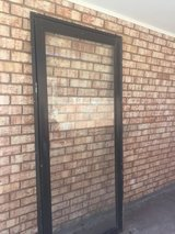 Glass screen door in Alamogordo, New Mexico
