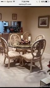 Glass top dining table with 6 chairs in Fort Sam Houston, Texas