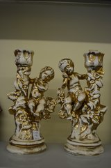 Pair of Cream and Gold Cupid Candlesticks in Warner Robins, Georgia