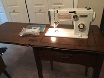 Sewing Machine with Cabinet.  Still have instruction book in Byron, Georgia