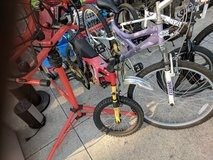 Two kids bikes and a tricycle in Camp Lejeune, North Carolina