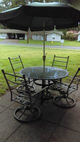 Outdoor table/chairs/umbrella set in Fort Lewis, Washington
