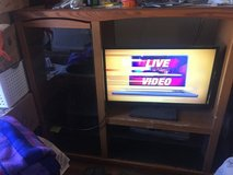 Entertainment center. All wood/glass doors in Alamogordo, New Mexico