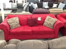 Red couch and love seat in Camp Lejeune, North Carolina