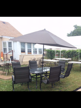 Patio table with six chairs and umbrella in Aurora, Illinois