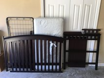 Convertible crib with matching changing table in Moody AFB, Georgia