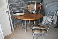Metal and wood table with 4 chairs in Byron, Georgia