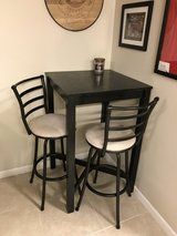 Pub style table and 2 swivel chairs in Bolingbrook, Illinois