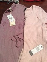 2 shirts new with tags, size S/M in Warner Robins, Georgia