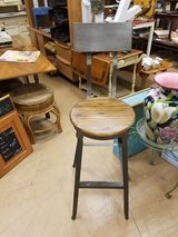 Welded metal vintage style drafting table type bar stool chair with wooden seat in Chicago, Illinois