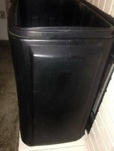 Large black rolling raised planter or very large party cooler has drai in Roseville, California