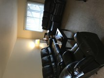Black leather reclining couch set in Watertown, New York