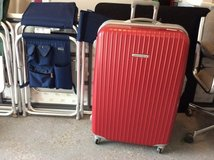 Red hard shell suitcase. in Los Angeles, California
