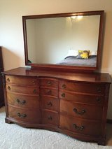 2 Beautifully detailed dovetail curved matching Cherry Dressers with 1 mounted Mirror in Shorewood, Illinois