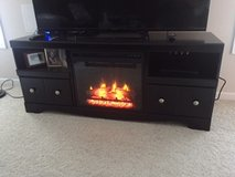 Entertainment center with electric fireplace and room heater in Fort Knox, Kentucky