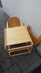 Wooden high back chair and eating table in Ramstein, Germany