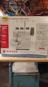 Singer finishing touch serger sewing machine in Pleasant View, Tennessee